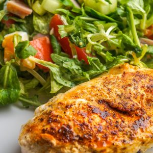 cooked chicken with salad